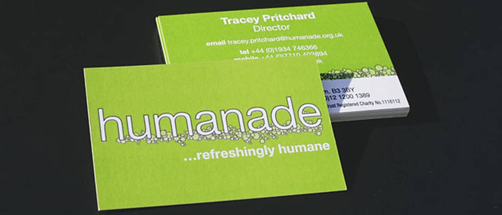 humanade business cards on black background