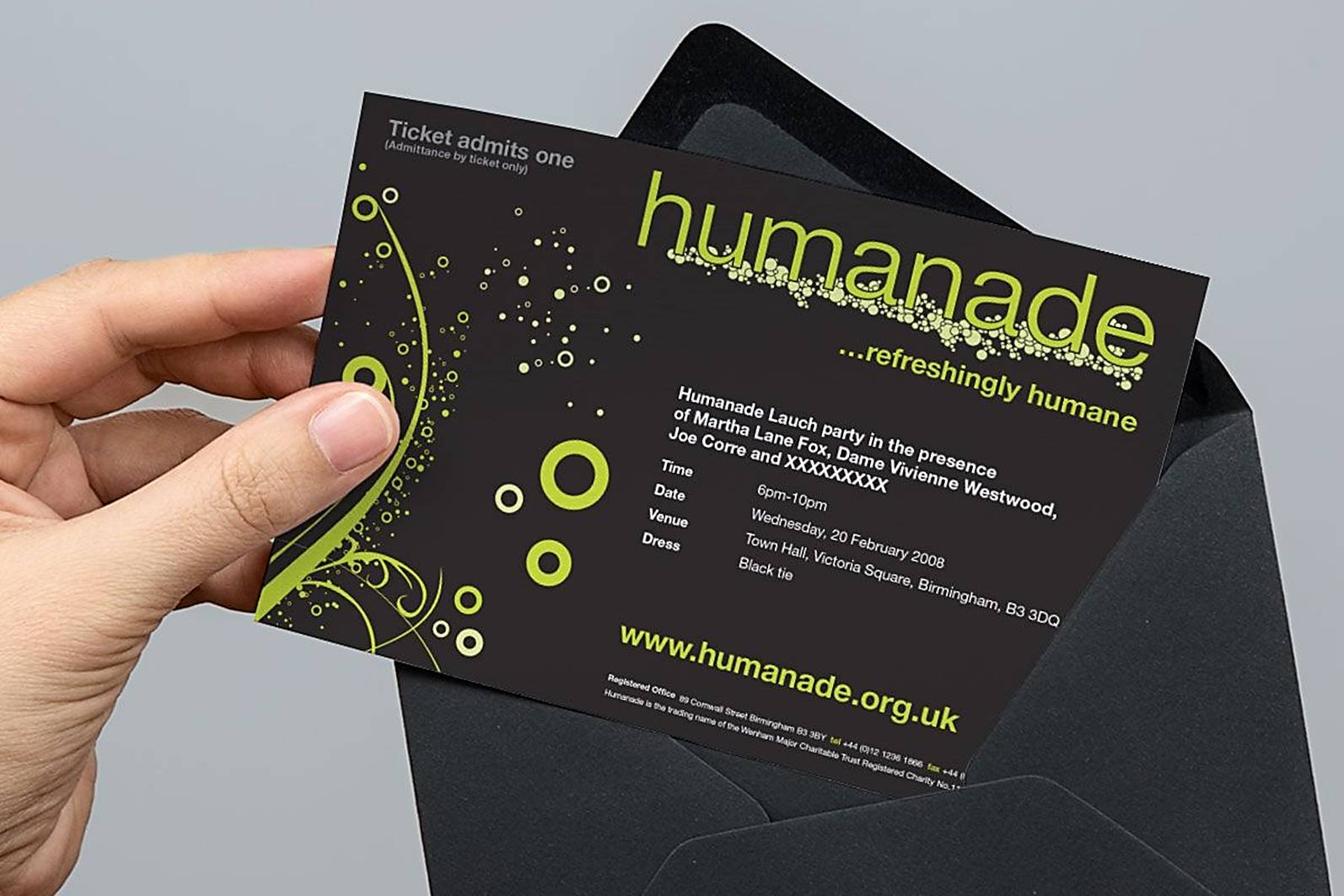 hand taking invitation out of black envelope