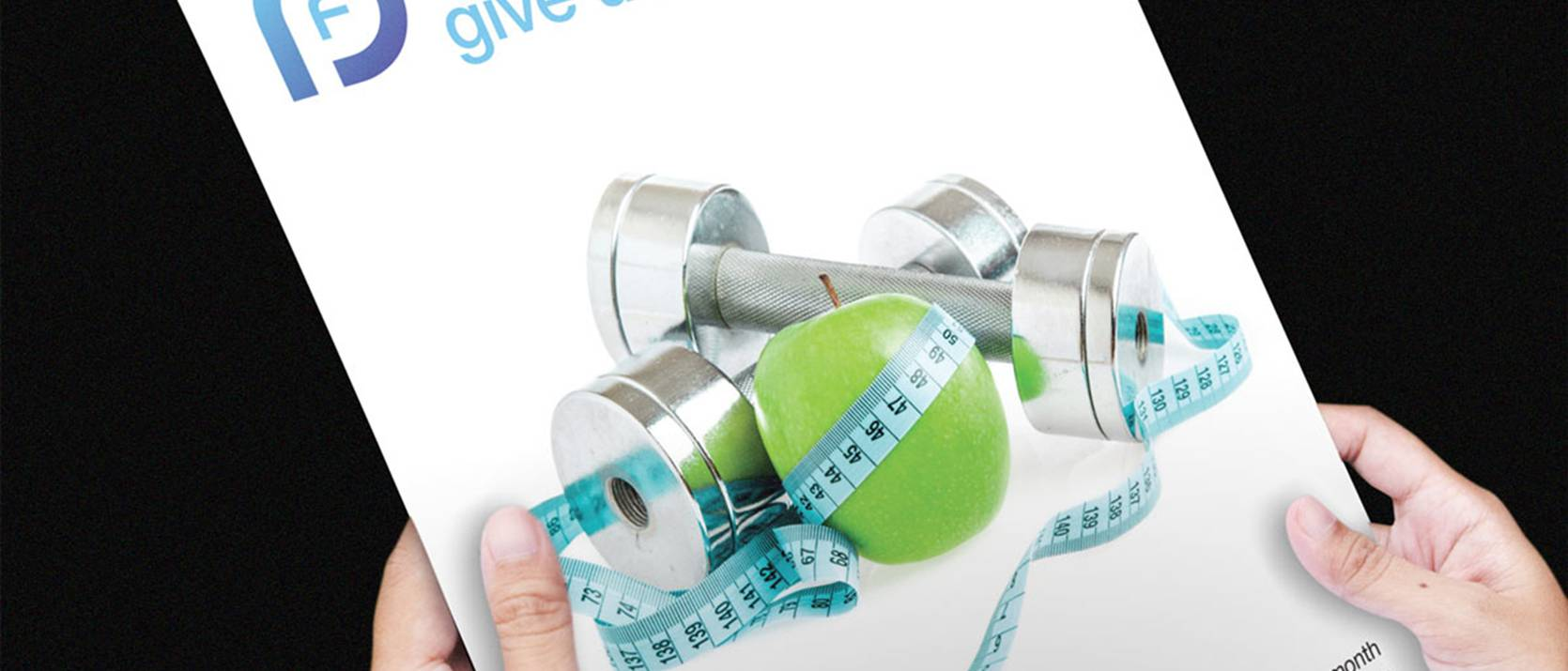 hands holding flyer, apple, measuring tape, hand held weights