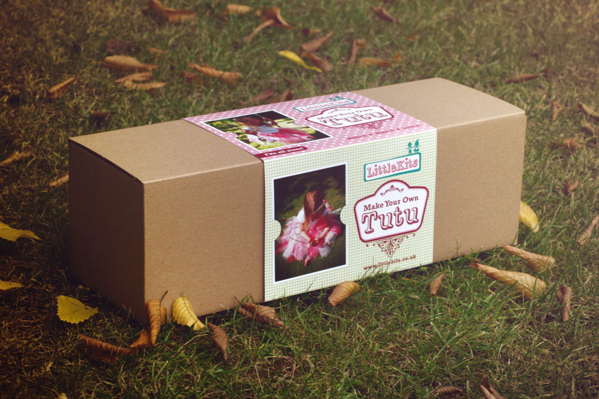 cardboard box on grass with leaves