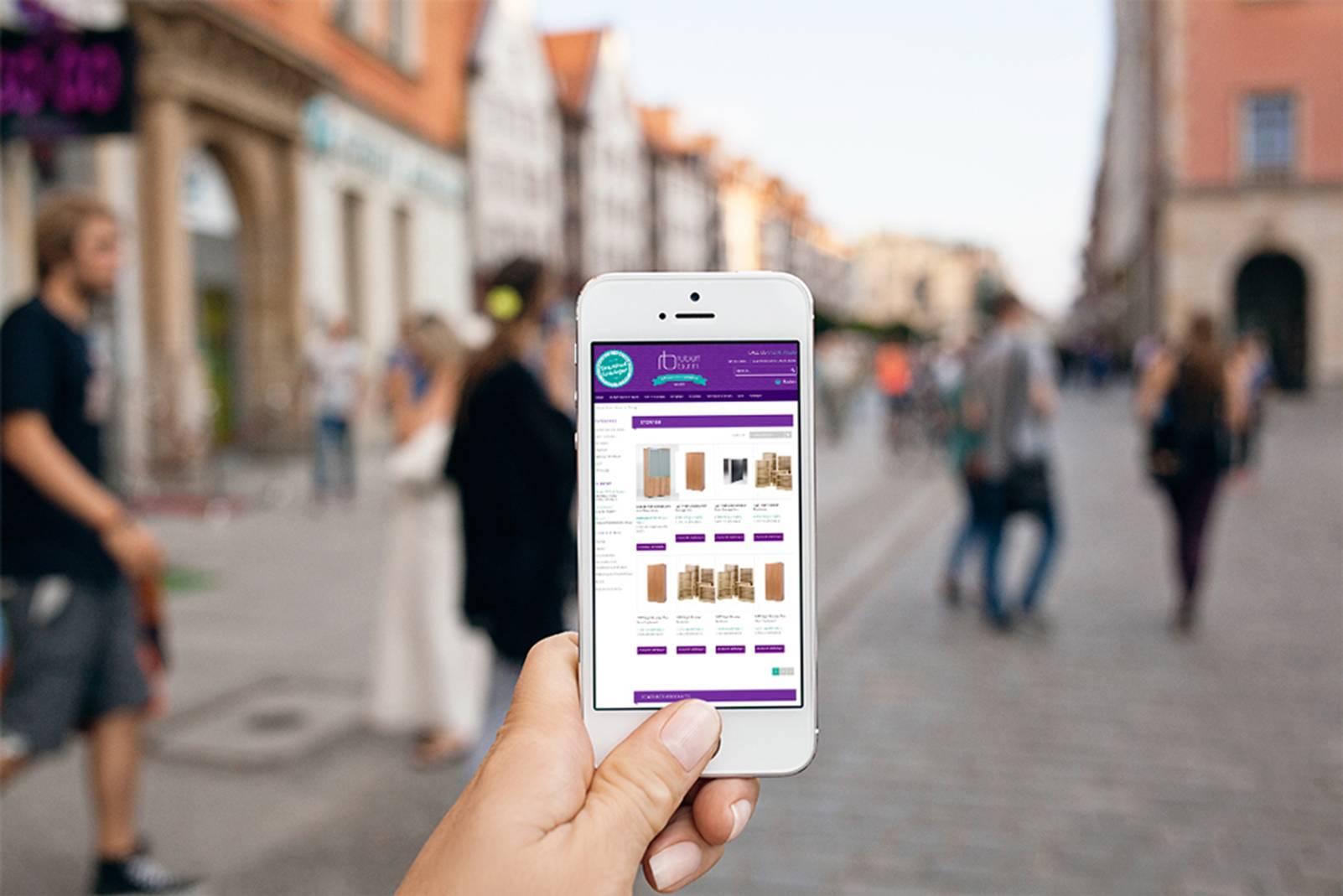 mobile phone being held in street