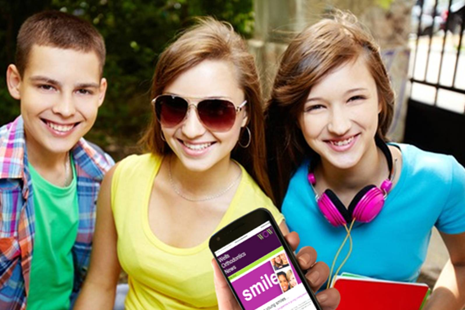 teenagers, sunglasses, mobile phine, pink headphones