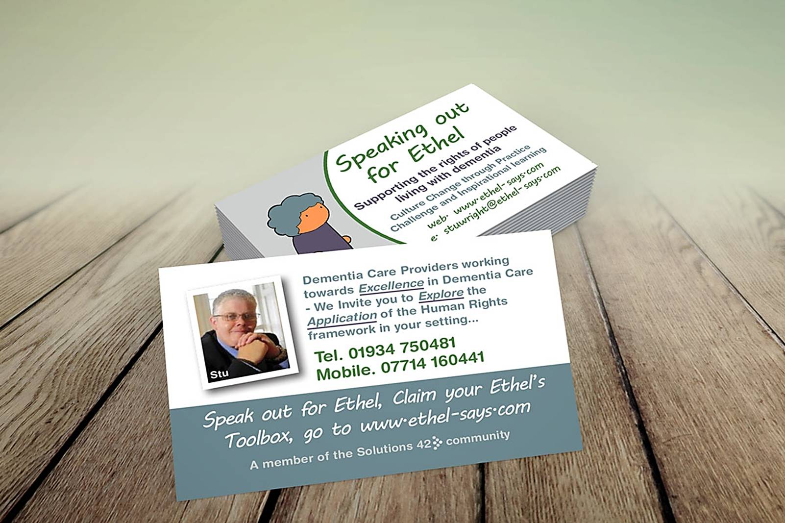 business cards on wooden surface